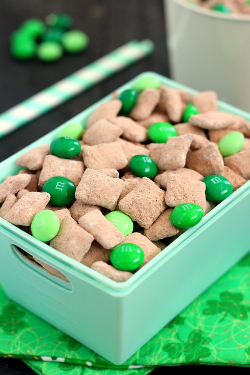 Mint Brownie Muddy Buddies make the most deliciously, decadent snack! Chex cereal is coated in creamy mint chocolate, and then tossed with brownie mix. It creates an irresistible treat that's perfect to serve for St. Patrick's Day, or any other time when you need a chocolate fix!