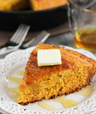 This Skillet Honey Cornbread is soft, moist, and bursting with flavor. The batter is sweetened with honey and cinnamon, and then baked in a skillet until golden brown. It results in a crispy topping and a tender middle, perfect for serving alongside your favorite meal or just to snack on!