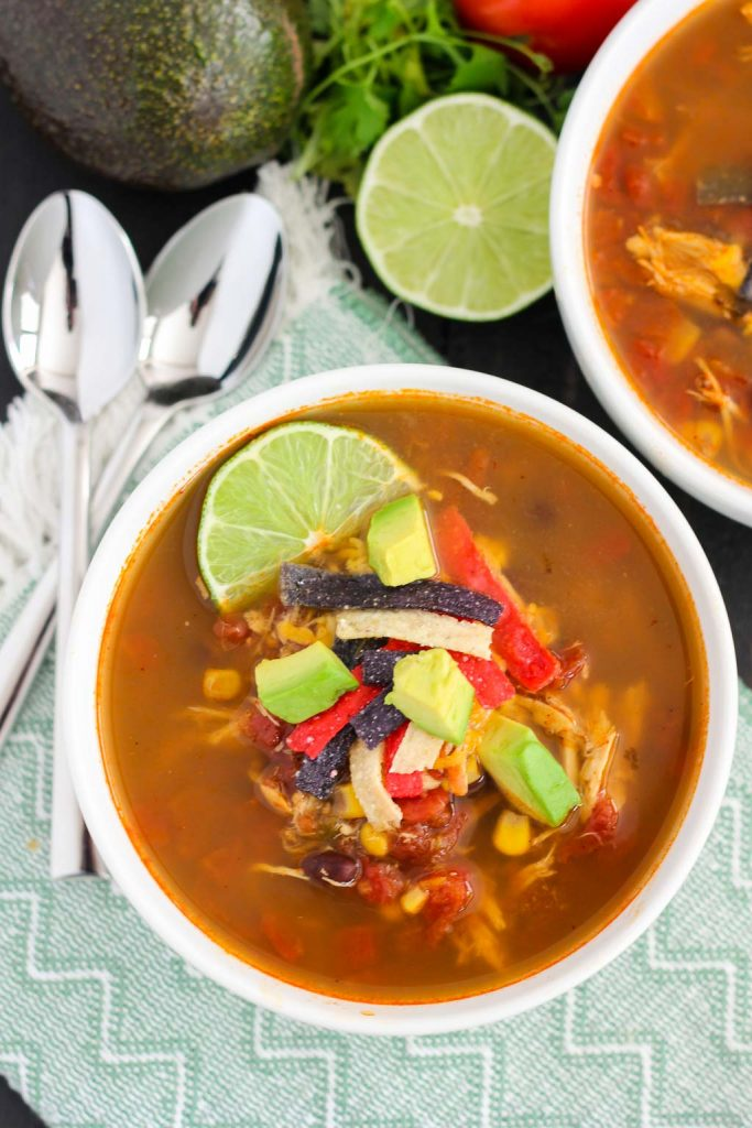 Soup is filled with tender chicken, diced tomatoes, corn, black beans ...