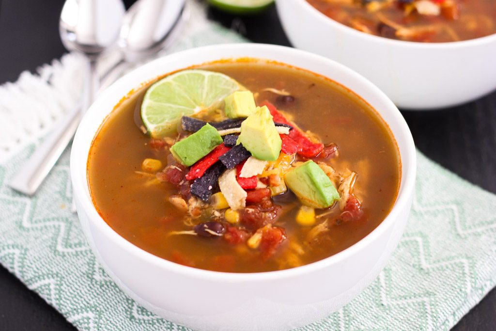 This Slow Cooker Chicken Tortilla Soup is filled with tender chicken, diced tomatoes, corn, black beans, and a combination of spices. With hardly any prep work involved, this flavorful meal will quickly become a household favorite!