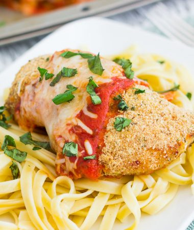 This Baked Chicken Parmesan is coated with a crispy, seasoned crust and baked to perfection. Topped with a rich sauce and mozzarella cheese, this easy meal is perfect for busy weeknights and will be your new favorite dish!