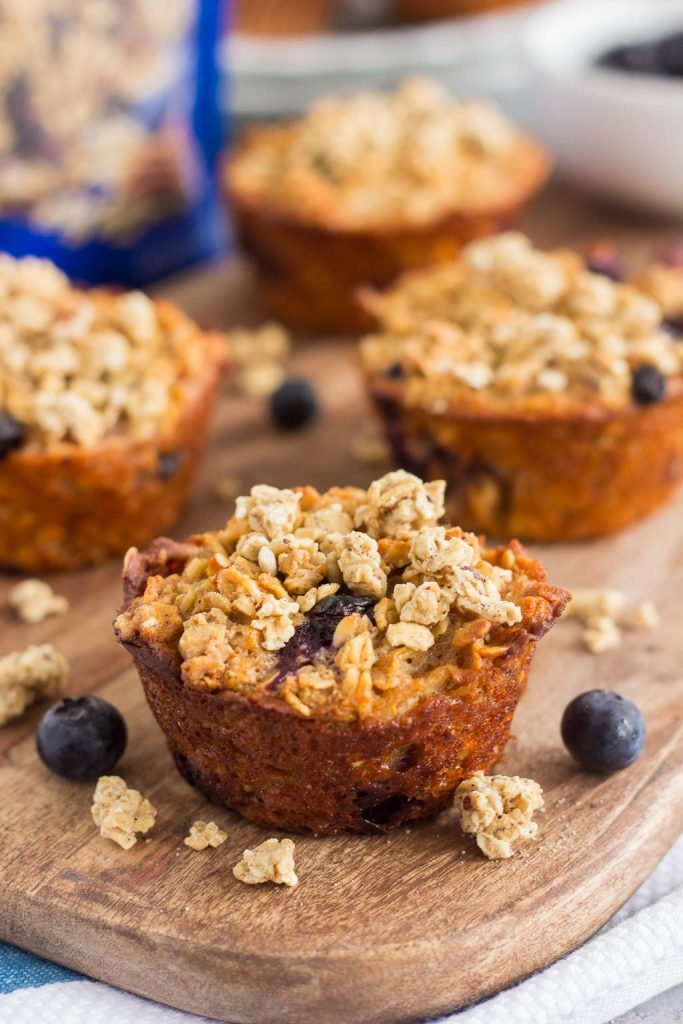 These Blueberry Granola Oatmeal Muffins are packed with hearty oats, fresh blueberries, and topped with sweet granola. Crunchy on the outside and soft on the inside, this simple breakfast can be prepped the night before and made in the morning. These muffins make the most deliciously easy on-the-go breakfast or snack!