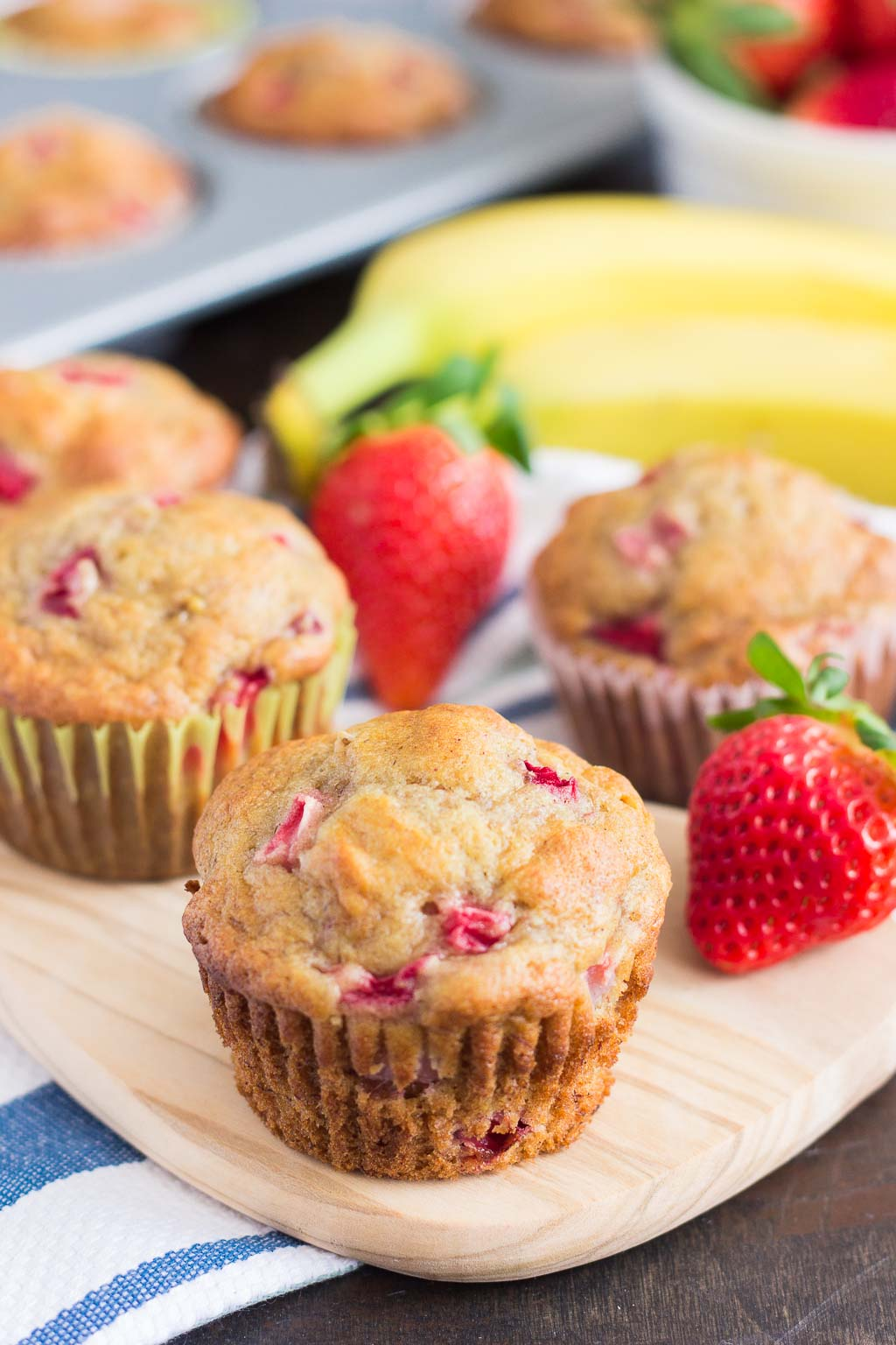 strawberry banana muffins on a cutting board