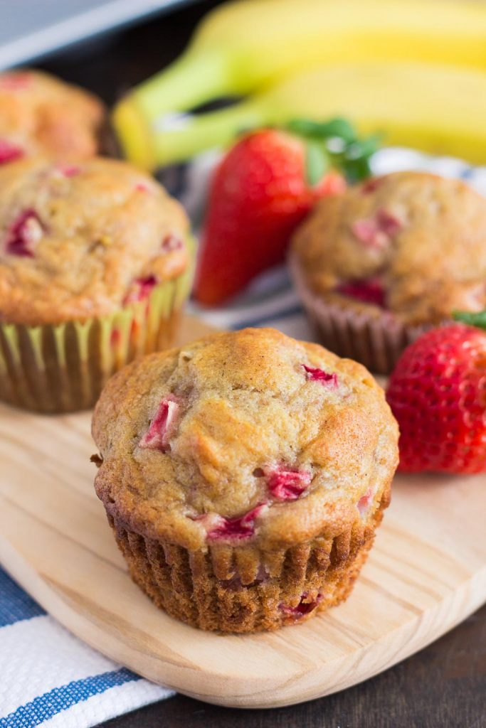 These Strawberry Banana Muffins are packed with fresh strawberries and sweet bananas, which yields a deliciously moist and flavorful treat. Easy to make and even better to eat, these muffins are sure to become your favorite breakfast or dessert!
