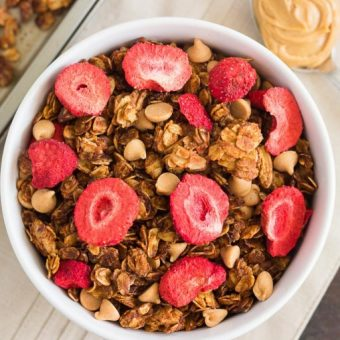 This Strawberry Peanut Butter Granola is packed with crunchy granola clusters, pecans, peanut butter chips, and strawberries. It's an easy treat that makes the perfect breakfast or snack to satisfy your peanut butter cravings!