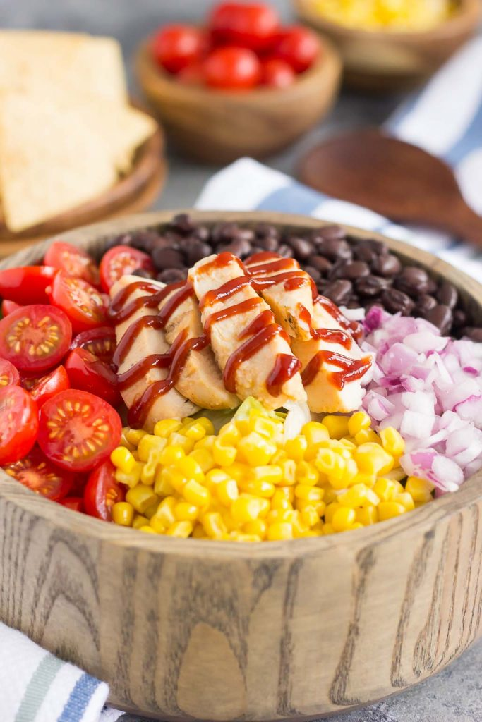 This Barbecue Ranch Chicken Salad is packed with fresh greens, tender chicken, black beans, corn, tomatoes, red onion, and avocado. It's tossed with a creamy barbecue