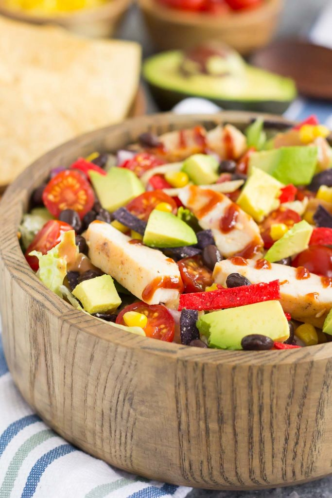 This Barbecue Ranch Chicken Salad is packed with fresh greens, tender chicken, black beans, corn, tomatoes, red onion, and avocado. It's tossed with a creamy barbecue ranch dressing and is full of flavor. Better than the restaurant version and so easy to make, you'll love the fresh ingredients in this easy summer salad!