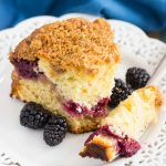This Blackberry Crumb Coffee Cake features a soft and moist cake, filled with a layer of cinnamon streusel and juicy blackberries. Sprinkled with a crumb topping and baked until perfect, this coffee cake makes a delicious breakfast or light dessert!