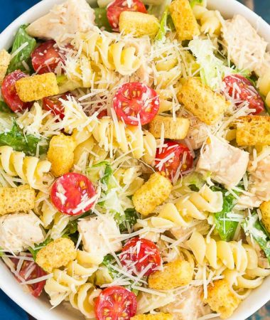 This Chicken Caesar Pasta Salad is a simple dish that's ready in less than 30 minutes. Romaine lettuce, fresh pasta, chicken, and Parmesan cheese are tossed in a creamy caesar dressing that's full of flavor. Light, yet filling, this easy dish makes a delicious weeknight meal!