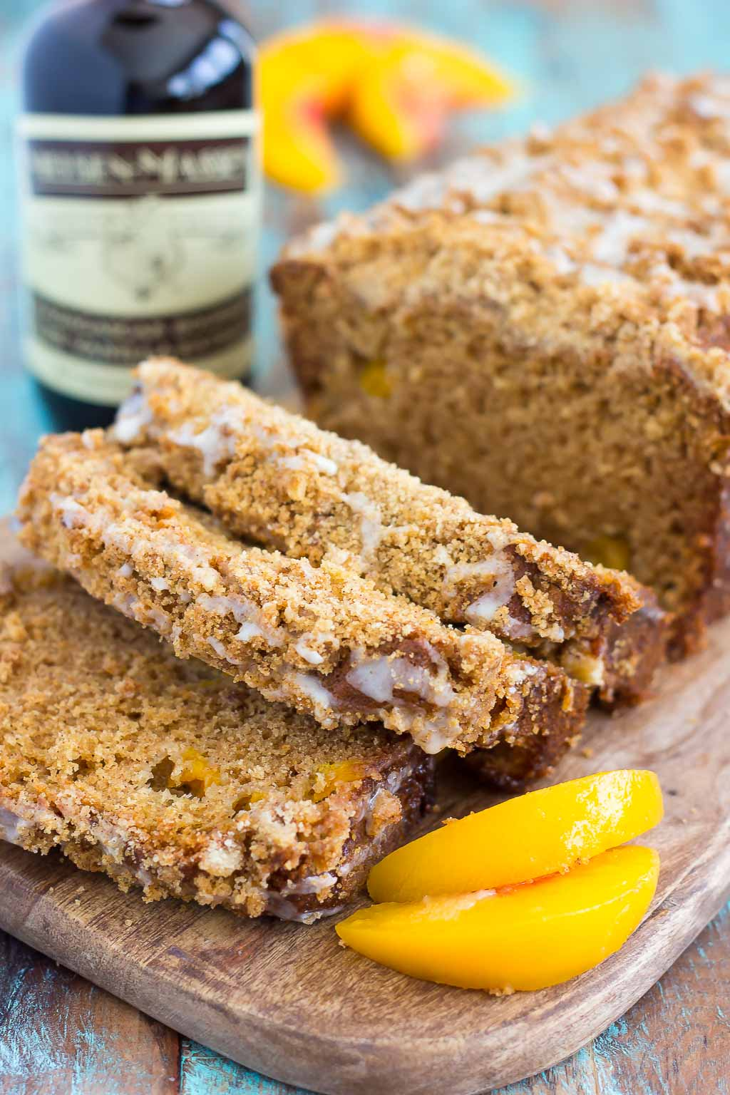 This Glazed Peach Streusel Bread is packed with juicy peaches and topped with a cinnamon crumble and sweet vanilla glaze. You'll fall in love with the soft and fluffy texture and deliciously sweet flavor!