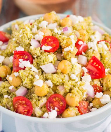 This Quinoa and Chickpea Pesto Salad is filled with chickpeas, hearty quinoa, cherry tomatoes, red onions, and crumbled feta cheese. It's tossed with a zesty pesto sauce that packs a punch of flavor in every bite. It's easy to prepare and makes simple dish that's perfect for lunch or dinner!