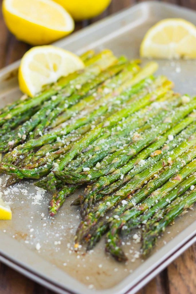 angled shot of roasted lemon asparagus in a pan
