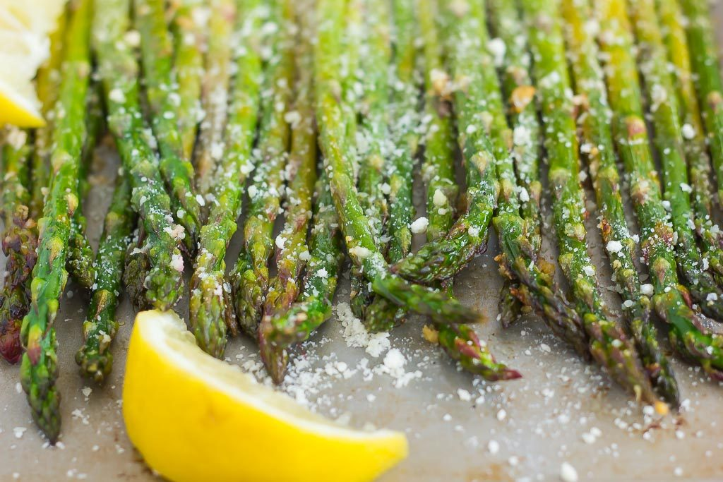 parmesan asparagus in a pan with lemon