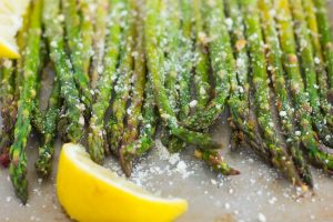 asparagus in a pan with lemon