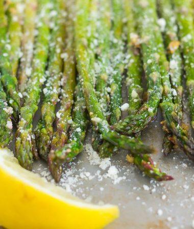 asparagus in a pan with lemon