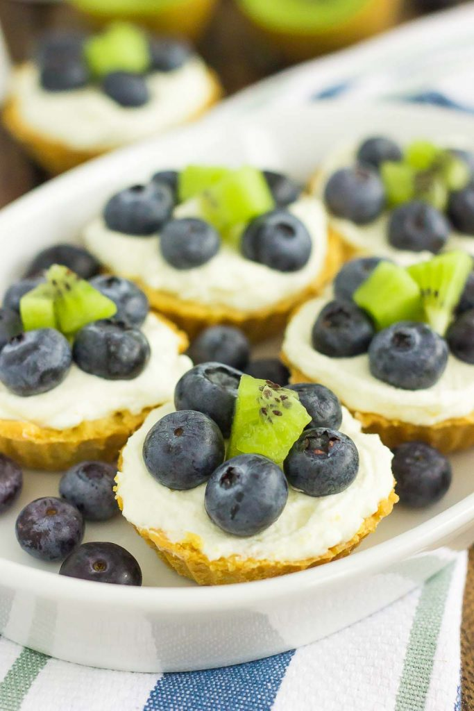 These Mini Blueberry Kiwi Tarts start with a simple, vanilla crust that's packed with a creamy mascarpone filling and topping with fresh blueberries and kiwi. This easy, make-ahead dessert is perfect to serve for your next party or get-together!