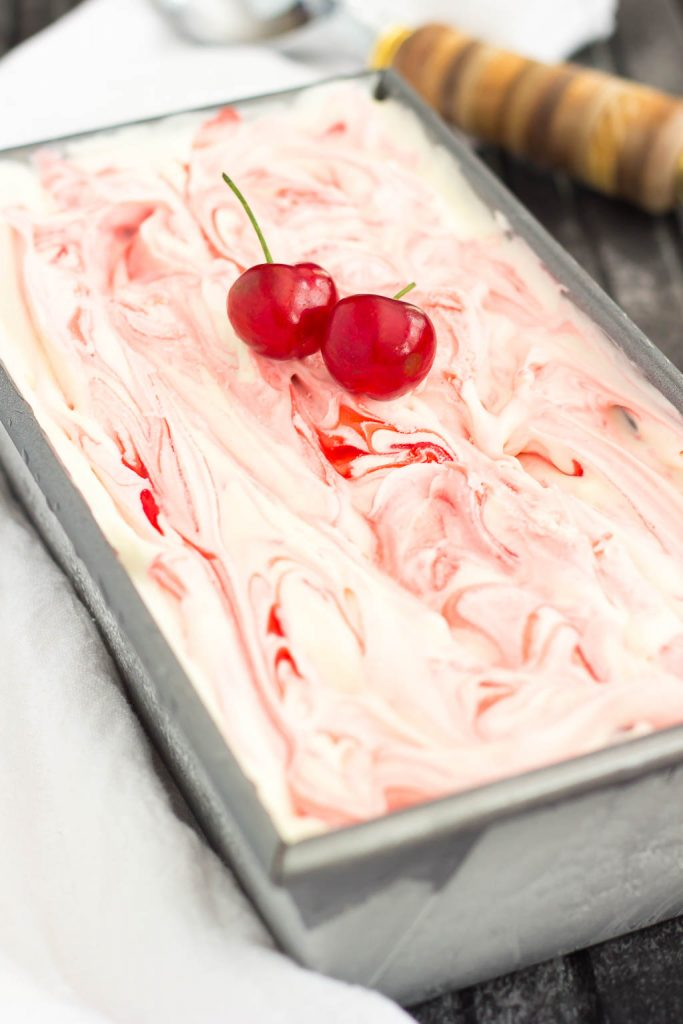 This easy, five ingredient Cherry Cheesecake Ice Cream is cool, creamy and packed with flavor. This no-churn treat features a vanilla cheesecake base that's loaded with juicy cherries. And best of all, it's made without an ice cream maker!