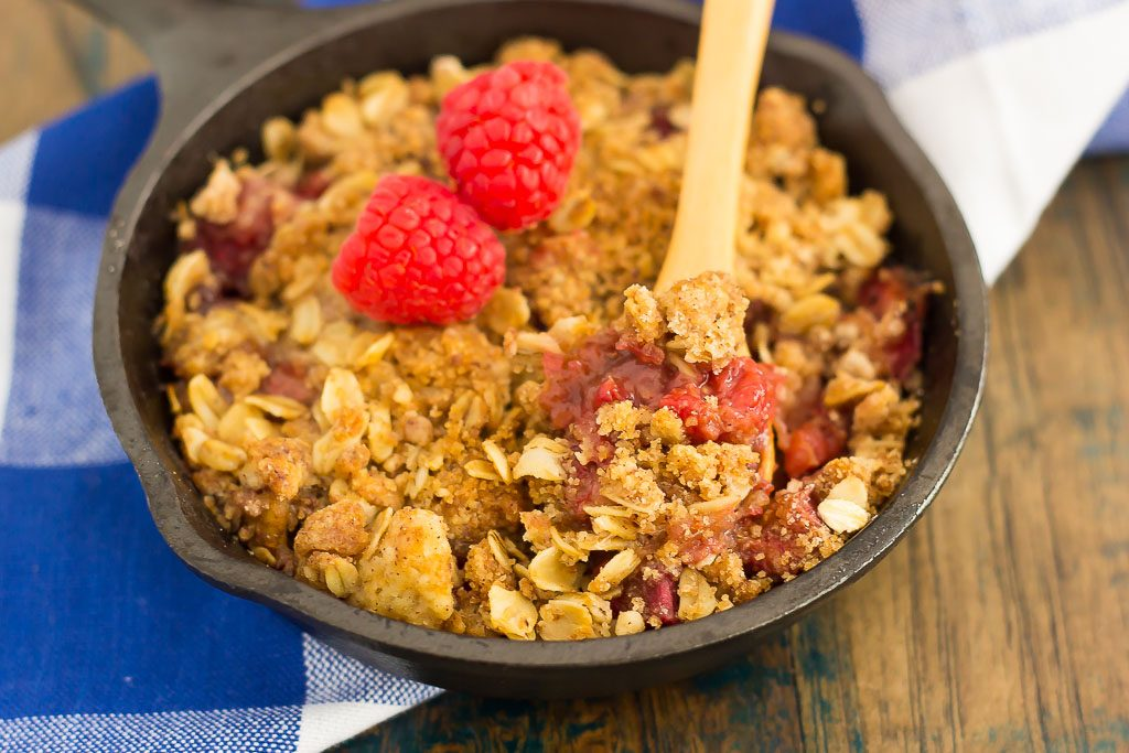 This Raspberry Rhubarb Crisp is filled with sweet raspberries, fresh rhubarb, and sprinkled with a brown sugar oat crumble. It's prepared in just minutes and makes an easy dessert that's perfect to enjoy all year long!