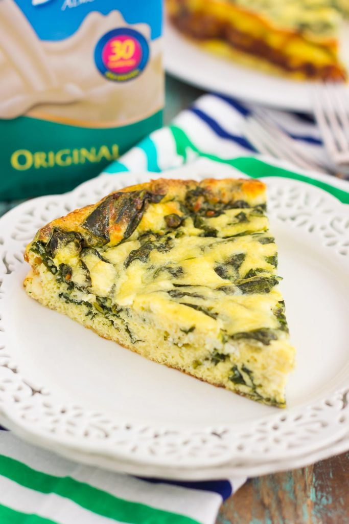This Spinach and Feta Frittata is full of fresh spinach and creamy feta cheese. It's healthy, gluten free, and perfect for just about any meal. If you're looking for that delicious meatless dish for breakfast, brunch, or dinner, then this is it!