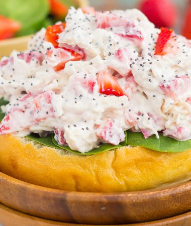 This Strawberry Poppy Seed Chicken Salad is packed with shredded chicken, a light dressing of Greek yogurt and mayo, and bursting with juicy strawberries and poppy seeds. This dish is fresh, flavorful, and filled with just the right amount of sweetness!