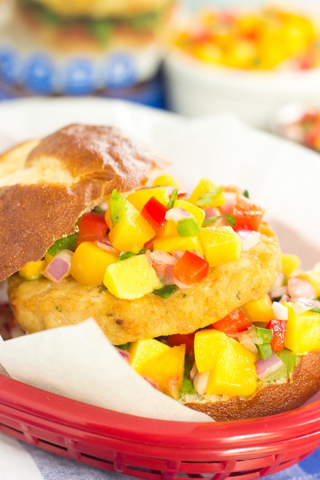 These Alaskan Pollock Burgers with Peach Mango Salsa are easy to prepare and bursting with flavor. The Alaskan Pollock patty provides a mild taste, while the peach mango salsa gives it the perfect touch of sweet and spicy. If you're looking for a new burger filed with the tastes of summer, then this is it!