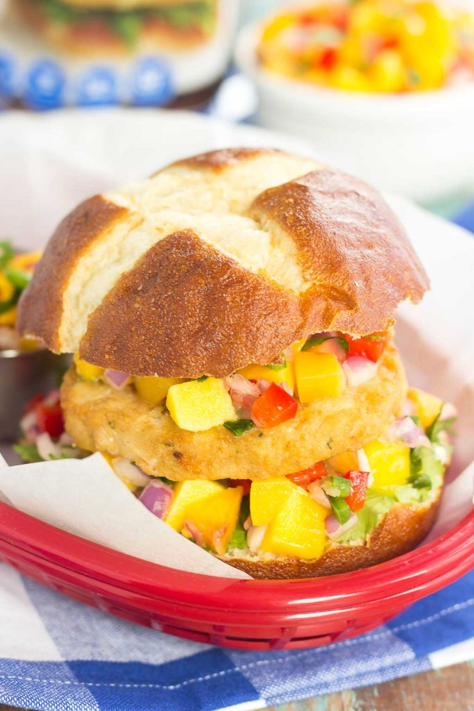These Alaskan Pollock Burgers with Peach Mango Salsa are easy to prepare and bursting with flavor. The Alaskan Pollock patty provides a mild taste, while the peach mango salsa gives it the perfect touch of sweet and spicy! #burger #pollock #pollockburger #peachsalsa #mangosalsa #summerburger #easyburger #dinner