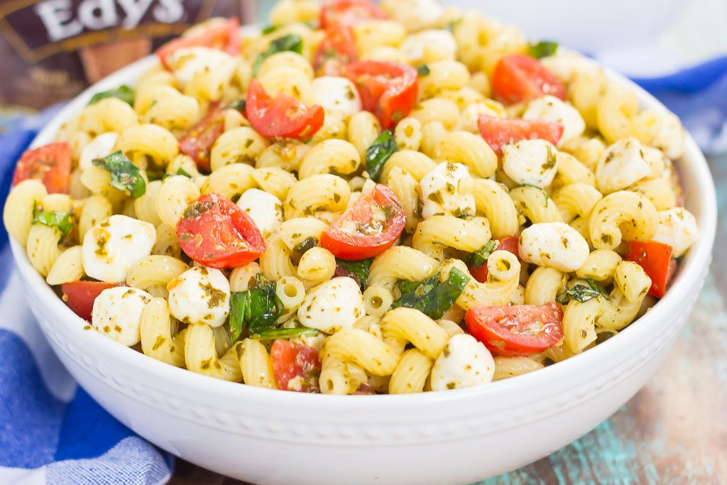 This Caprese Pasta Salad is filled with tender noodles, cherry tomatoes, fresh basil, and creamy mozzarella cheese. It's tossed in a white balsamic and pesto dressing, which gives this dish a burst of flavor. Simple, fresh, and full of flavor, this pasta salad is ready in minutes and is perfect for summer!