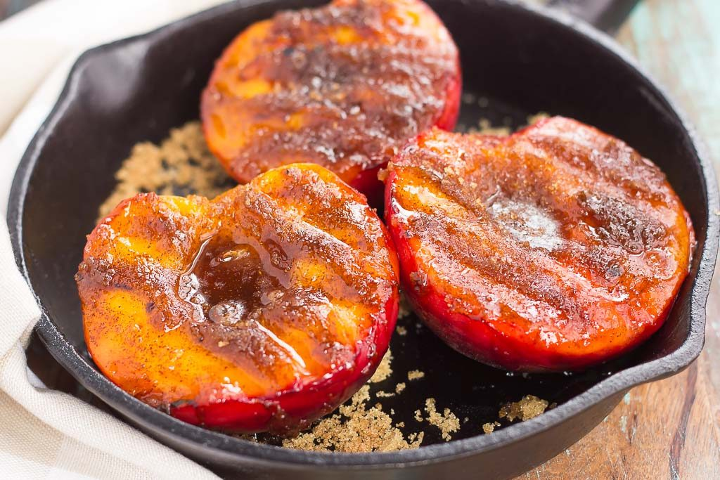 These Grilled Peaches with Cinnamon and Brown Sugar are a delicious, healthier dessert. Fresh peaches are lightly grilled and then topped with a cinnamon and brown sugar mixture that caramelizes to perfection. With just four ingredients and hardly any prep time, you can have this easy dish ready in minutes!
