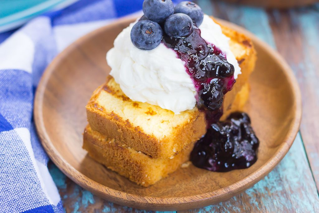 This Grilled Pound Cake with Mascarpone Cream and Blueberries is an easy dessert that's perfect for summer. Slices of pound cake are lightly grilled and topped with mascarpone whipped cream and blueberries. Fast, fresh, and simple to prepare, this dish is ready in less than 20 minutes and is sure to be a crowd-pleaser!