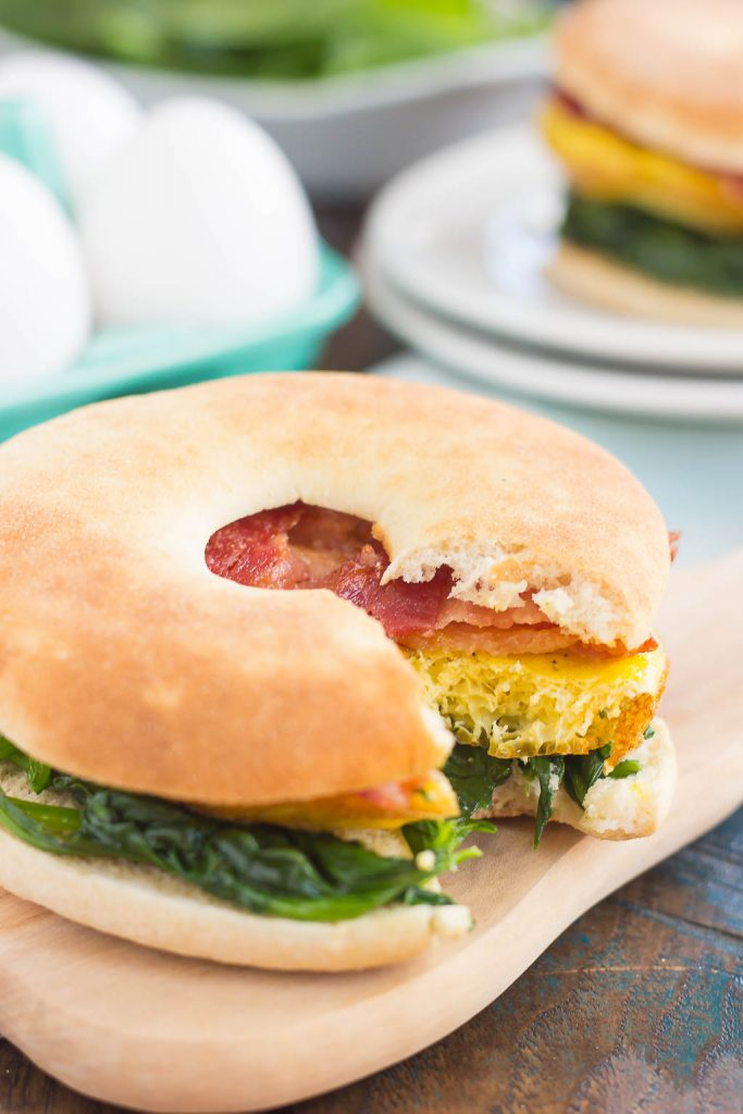 This Spinach, Bacon and Feta Breakfast Sandwich is an easy, make-ahead dish that's full of fresh ingredients. Fluffy eggs are seasoned with creamy feta cheese, and then topped sautéed spinach and smoky bacon. This sandwich makes a delicious and hearty breakfast for those busy weekday mornings!