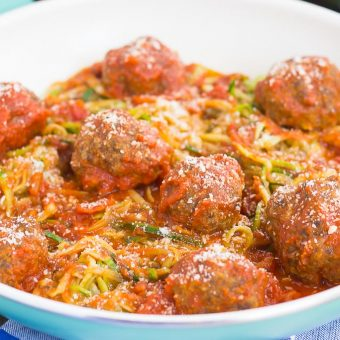 These Tomato Basil Zoodles with Meatballs makes a simple, fresh, and easy weeknight meal. Filled with fresh zucchini noodles, a tomato basil marinara sauce, and hearty meatballs, this dish comes together in minutes and is bursting with flavor!