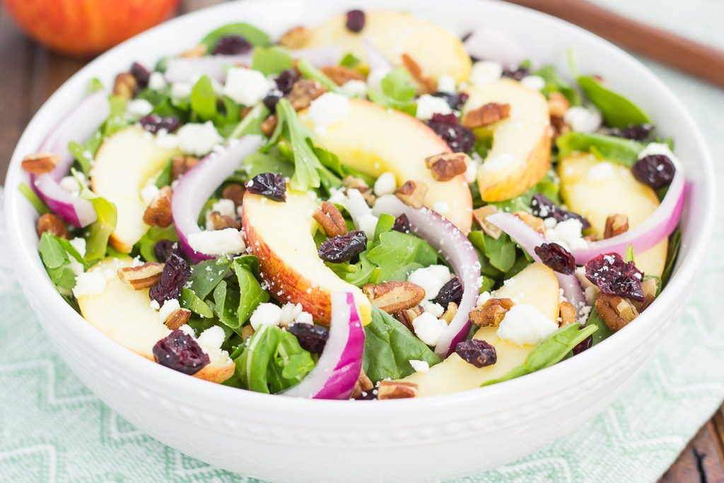 This Apple Cranberry Pecan Salad with Honey Cider Vinaigrette is sweet, savory, and comes together in minutes. Featuring fall-inspired ingredients, such as fresh apple slices, dried cranberries, red onion, pecans, and feta, this salad is full of flavor and makes a healthier lunch or dinner!