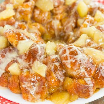 This Apple Pie Monkey Bread is a deliciously sweet and easy dish that makes the perfect breakfast or dessert! With just a few and minimal prep time, this pull-apart bread is soft, gooey, and bursting with apple chunks and warm spices. One bit and this will become your favorite fall treat!