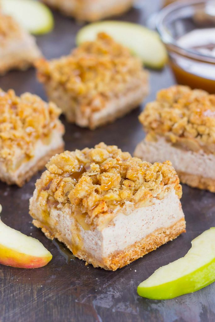 These Caramel Apple Cheesecake Bars are filled with an apple pie cheesecake batter and then sprinkled with tender apples, a sweet streusel topping, and a drizzle of caramel. Simple to prepare and even better to eat, this dessert captures the delicious flavors of fall! #cheesecake #cheesecakerecipes #cheesecakebars #applecheesecakerecipe #caramelapplerecipe #falldesserts #falldessertrecipe