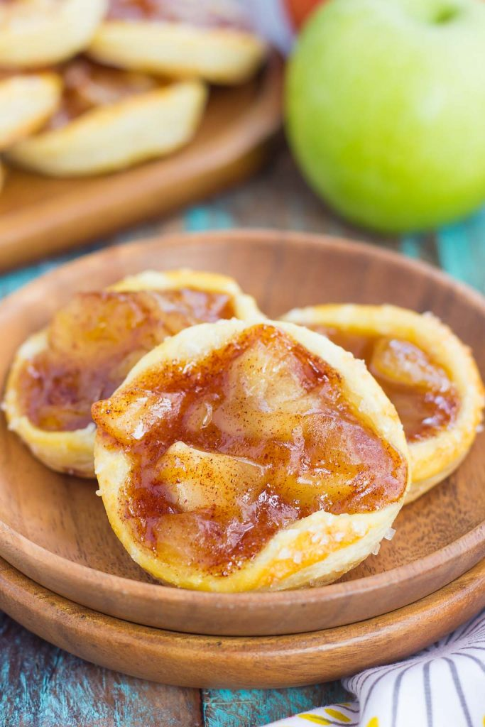 These Caramel Apple Danish are filled with tender apples that are sprinkled with cinnamon and brown sugar, and then topped with a rich, caramel sauce. Made from a puff pastry base and simple ingredients, you can have this easy breakfast or dessert ready in less than 30 minutes!