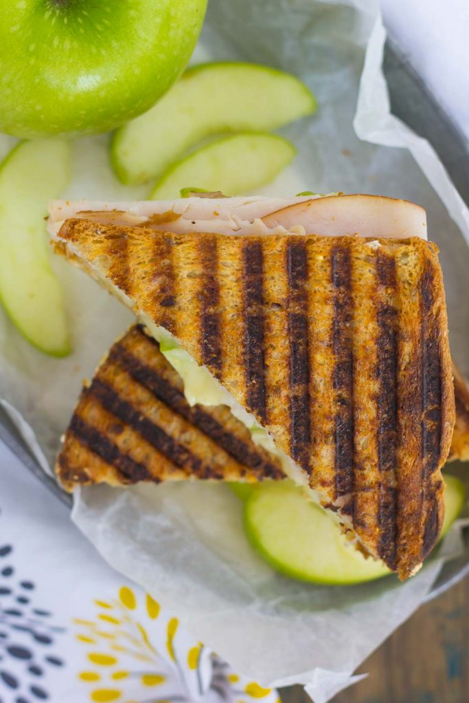 This Turkey, Apple and Brie Panini is the perfect fall-inspired sandwich. It's packed with fresh turkey, granny smith apples, creamy brie cheese and then toasted until golden. Simple, fast, and bursting with flavor, this sweet and savory combo makes a delicious lunch or dinner!