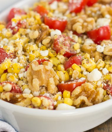 Grilled Garlic Herb Corn and Tomatoes with Walnuts is an easy side dish that's ready in minutes. Fresh corn off the cob, cherry tomatoes, feta cheese, and walnuts give this dish a flavorful punch that's perfect to pair alongside your favorite meal!