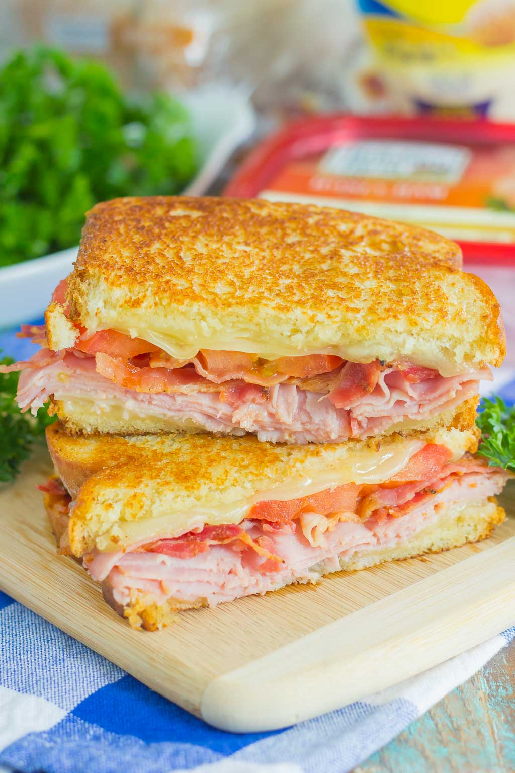 Thinly sliced honey ham, swiss cheese, fresh tomatoes, and crispy bacon are packed between fresh slices of bread that are grilled to perfection. With just six ingredients and hardly any prep work, you can have this Grilled Ham and Swiss Sandwich ready to be devoured in no time!