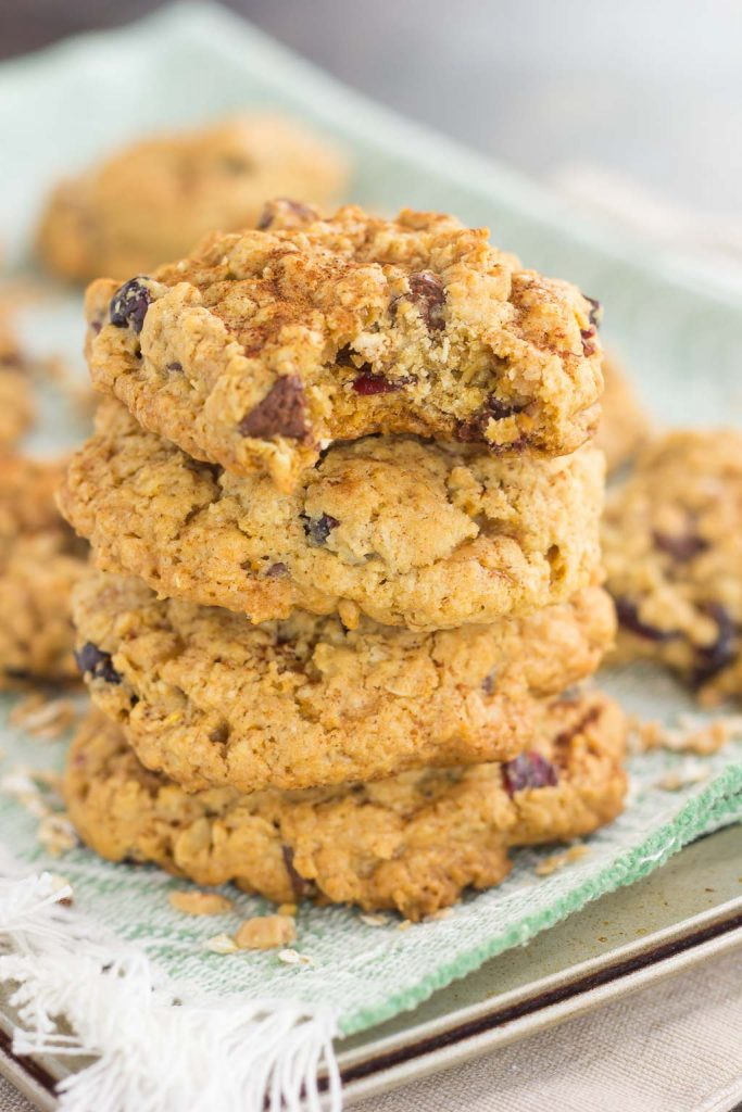 These Spiced Oatmeal Cookies are packed with hearty oats, warm spices, dried cranberries, chocolate chips, and toffee bits. Soft, chewy, and bursting with fall flavors, these cookies are perfect to enjoy all year long!