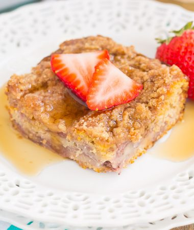 This Strawberry Cinnamon Pancake Casserole is a dish that the whole family will enjoy. Fluffy pancakes are studded with juicy strawberries, a cinnamon spread, and then back until golden. Topped sweet streusel and maple syrup, this dish is a wholesome, feel-good meal!