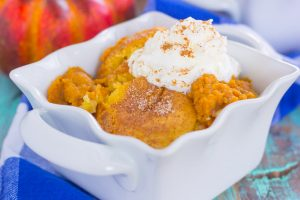 pumpkin cobbler in a white serving dish