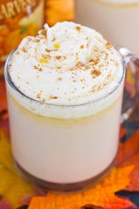 This Slow Cooker Pumpkin Caramel White Hot Chocolate is a deliciously sweet and creamy drink that's bursting with fall flavors. It's a perfect recipe to enjoy on a chilly evening and is so easy to make! Keep your crock pot on warm to impress those party guests! #pumpkin #pumpkindrink #pumpkinhotchocolate #pumpkinwhitehotchocolate #whitehotchocolate #hotchocolaterecipe #falldrink #drink #hotbeverage #hotchocolaterecipes #pumpkincaramelhotchocolate