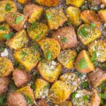 These Herb Roasted Potatoes are seasoned with Parmesan cheese, a variety of spices, and baked to perfection. Crispy on the outside and tender on the inside, this easy side dish comes together in minutes and is sure to be the hit of the dinner table!