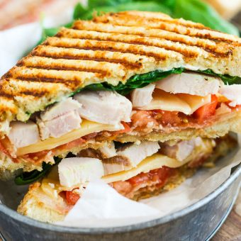 This Chicken Bacon Ranch Panini is fast, fresh, and ready in no time. Loaded with tender chunks of chicken, crisp bacon, fresh spinach, Havarti cheese, and a garlic ranch dressing, this sandwich is packed with flavor and makes the perfect, easy meal!