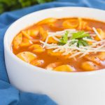 This Creamy Tomato Tortellini Soup is the perfect kind of comfort food for cold, winter days. Loaded with cheese tortellini, herbs, and made in one pot, you can have this rich and flavorful soup ready in less than thirty minutes!