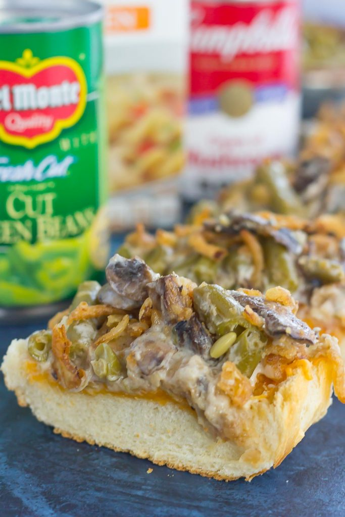 This Green Bean Casserole Cheesy Bread puts a creative spin on the classic holiday side dish. The zesty casserole is made in just one pan, piled on top of toasted cheesy bread, and then baked until warm and bubbly. This simple dish is fast, fresh, flavorful and will become the hit of the dinner table!