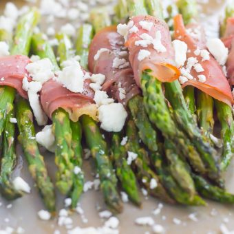 Fresh asparagus is wrapped in thin slices of prosciutto, roasted to perfection and then topped with crumbed feta cheese. Salty, crispy and packed with flavor, this Prosciutto Wrapped Asparagus with Feta makes an easy and delicious side dish!