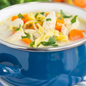 This Slow Cooker Lightened Up Creamy Chicken Noodle Soup is loaded with chicken, fresh vegetables, and tender noodles, all tossed in a creamy broth. Warm, comforting, and lightened up, you can feel good about indulging in the classic soup, with a creamy twist!