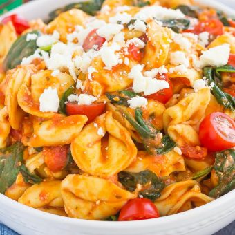 This Spinach and Feta Tortellini is fresh, flavorful, and ready in less than 30 minutes. Cheese tortellini is tossed in a zesty marinara sauce and sprinkled with fresh spinach and crumbled feta cheese. Easy to make and perfect for busy weeknights, this warm and comforting pasta will fill you up and keep you coming back for more!