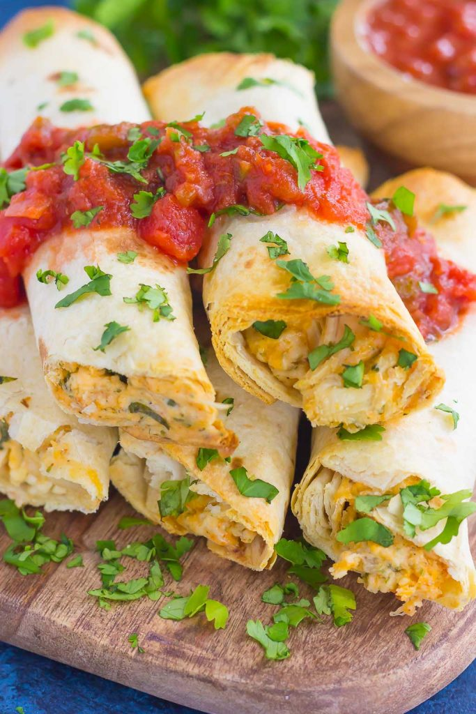 These Baked Chicken Ranch Taquitos are loaded with shredded chicken, cheddar cheese, cilantro, and a savory ranch cream cheese mixture. Fast, easy, and ready in less than 30 minutes, this simple dish is packed with flavor and perfect for the whole family!